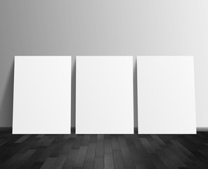 three blank white poster