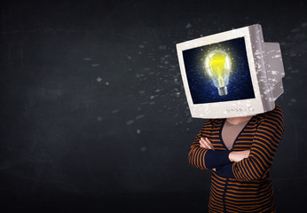 Young girl with a monitor head, idea light bulb on the display s
