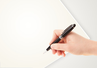 Hand writing on plain empty white paper copy space