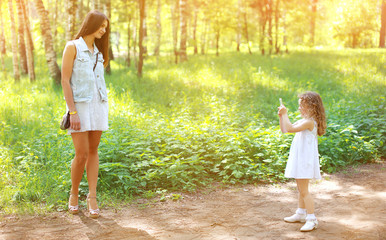Happy mother and daughter together having fun photographed