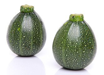 Two fresh green round Zucchini