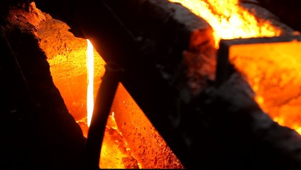 the molten metal is molten iron flowing along the trough