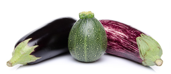 Purple and black eggplant and a zucchini