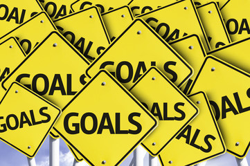 Goals written on multiple road sign