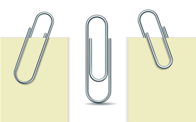 Metal paperclip and paper