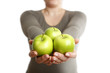 Woman holds three green apples into to camera