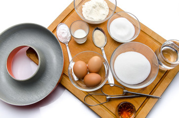 Ingredients to prepare a French ring cake, named savarin