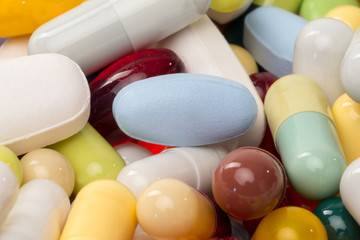 various pills and capsules as background