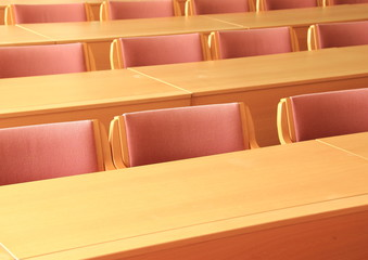 Empty conference room with wooden chairs facing front