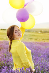 Beautiful pregnant woman in the lavender field