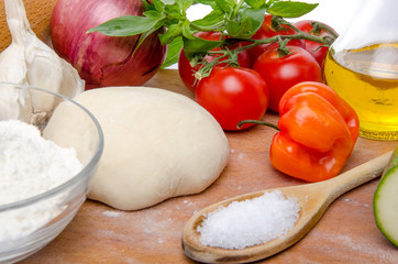 Different ingredients to make a pizza