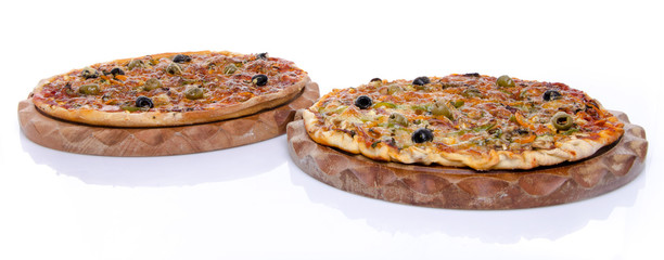 Two pizzas on a wooden board