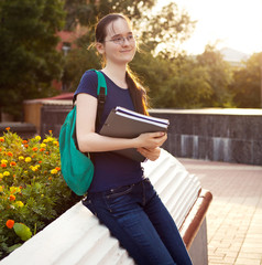 Female smiling student outdoors in the evening