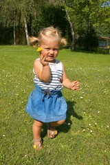 Child, a little girl having fun on the meadow