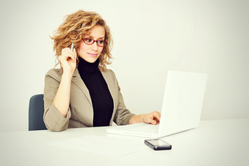 Businesswoman is working with Laptop