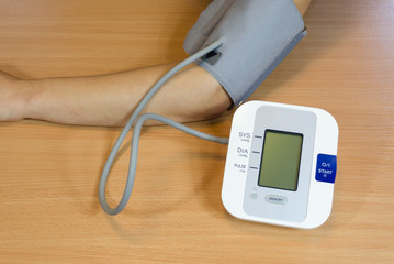 female patient check measure her blood pressure