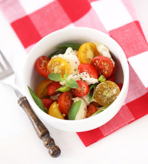 Caprese with red and yellow cherry tomatoes