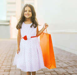 Beautiful little girl with shopping bag