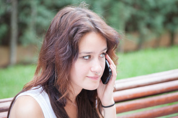 Clouse up of an anxious girl talking on smart phone.