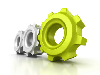 Three cogwheel gears with green leader on white background