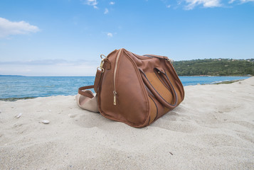 Leather bag on the beach