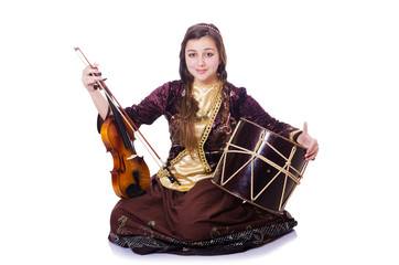 Young woman playing musical instruments on white