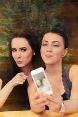 Young Women Taking a Funny Selfie Together