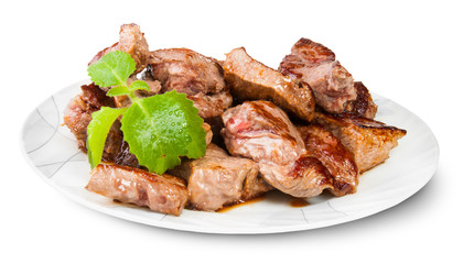 Grilled Meat On A White Plate Served With Mint Leaf