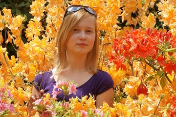 Teenage girl sniffing the flowers Azaleas