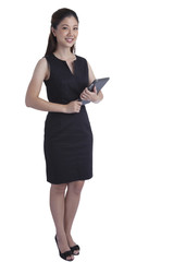 Asian business woman gesture attractive using a tablet smiling