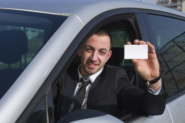 Business man in the car with empty ticket
