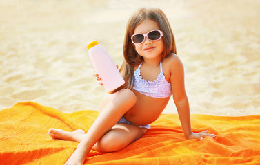 Child on the beach in the summer and sunscreen skin