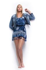 Young beautiful blond girl wearing blue jacket.
