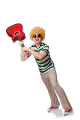 Man with afro wig with guitar on white