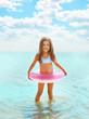 Leinwanddruck Bild - Happy child having fun bathing in sea
