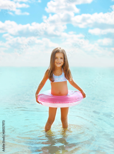 Leinwanddruck Bild Happy child having fun bathing in sea