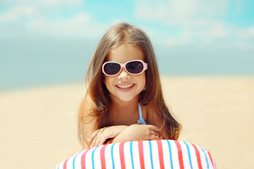 Joyful child resting on the beach in the summer, travel