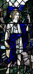 A young Jesus Christ as a sheperd in stained glass