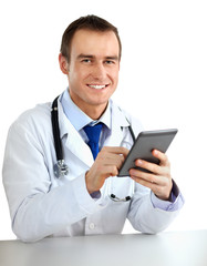 Handsome doctor using computer plane-table