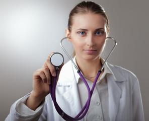 Close-up of female doctor using stethoscope