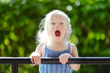 Adorable toddler girl making funny faces
