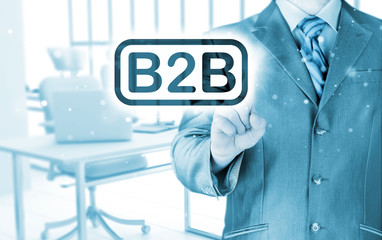 businessman pointing to word B2B,