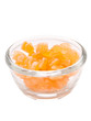 close up of a bowl of candied orange citrus peel isolated