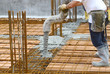 Workers pouring concrete with motion blur - 68042332