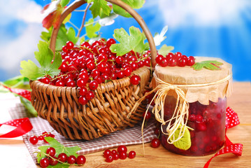 basket of fresh red currant and jar of preserve