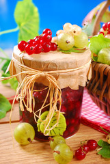 jar of preserve with fresh red,white currant and gooseberry