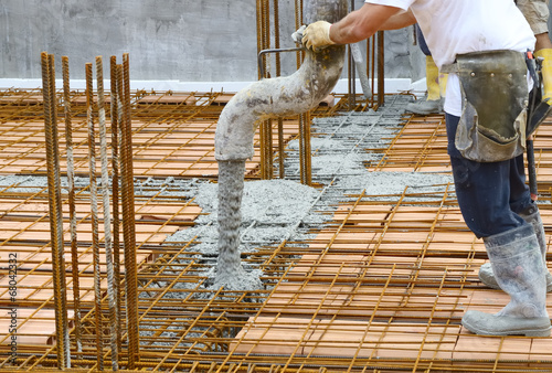 Workers pouring concrete with motion blur