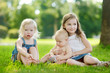 Three adorable little kids having fun outdoors