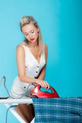 pinup blonde woman ironing
