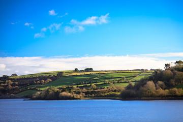 beautiful irish landscape green meadows at the river